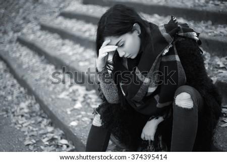 Sad teen girl outdoor feeling depressed - stock photo
