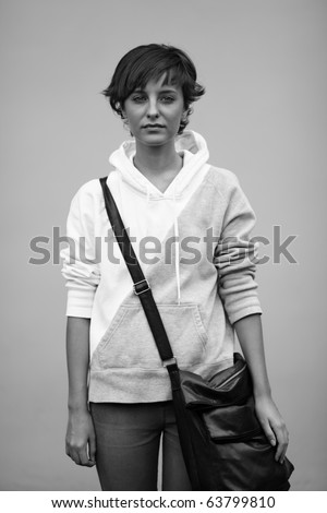 sad teen with black bag, soft natural light ,selective focus on face - stock photo