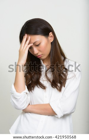 Sad teenage girl - stock photo