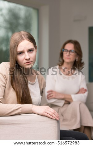 Sad teenage girl having a conflict with her mother
