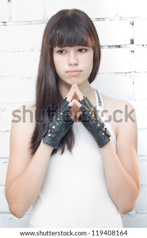 Sad teenager in black gloves - stock photo