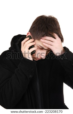Sad Teenager in the Coat with Cellphone Isolated on the White Background