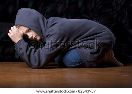 Sad teenager is in depression. - stock photo