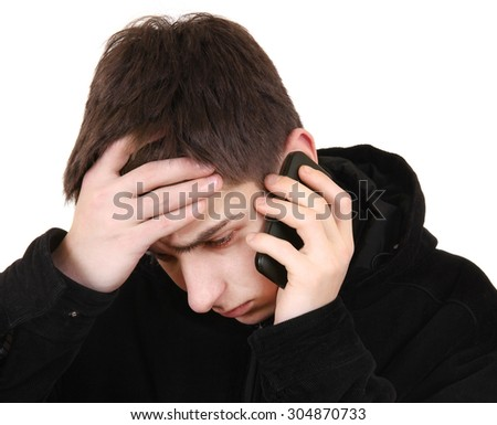 Sad Teenager with Cellphone Isolated on the White Background