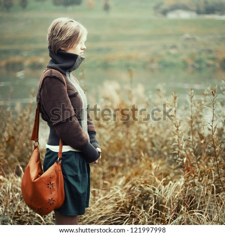 sad unhappy girl in the autumn forest, stress, depression - stock photo