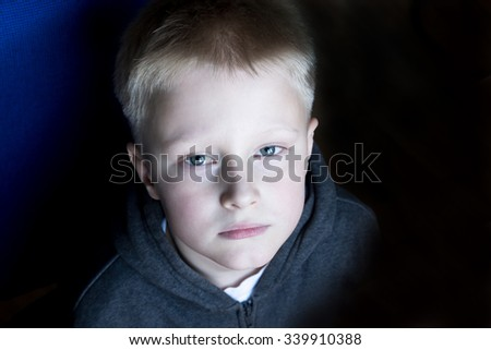 Sad upset waiting boring depressed child (boy, teen) with grey eyes, close up portrait  - stock photo