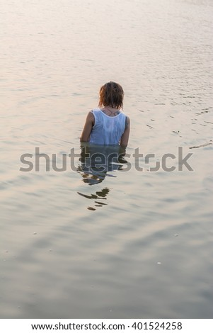 sad woman alone in the pond