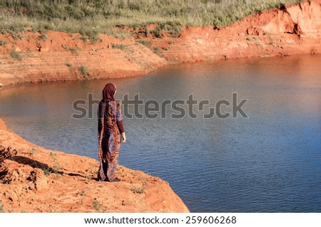 sad woman deep in thought outdoors. Depression. At the coast - stock photo