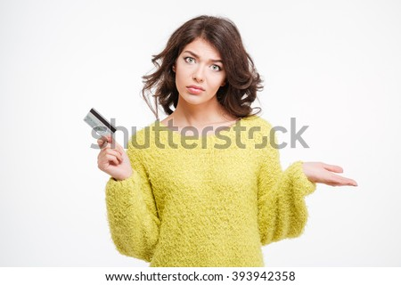 Sad woman holding bank card and copyspace on the palm isolated on a white background - stock photo