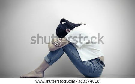 sad woman hug her knee and cry  - stock photo