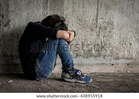 sad woman hug her knee and cry - stock photo