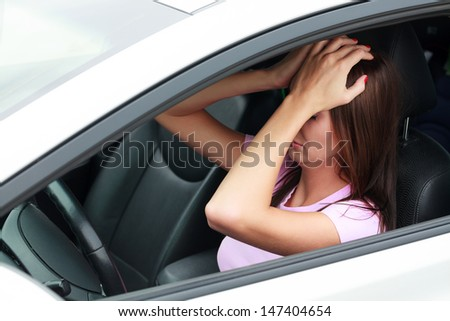 Sad woman in a car  - stock photo