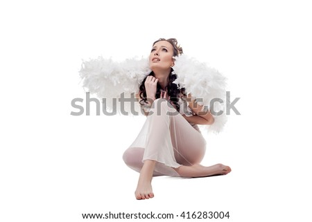 Sad woman in angel costume. Isolated on white - stock photo