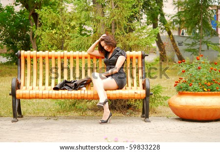 sad woman in the park - stock photo