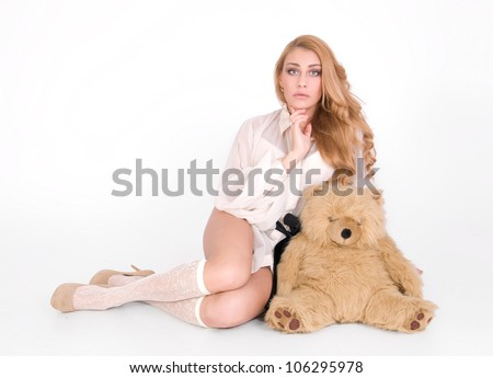 Sad woman is wondering and hug the plush teddy toy - stock photo