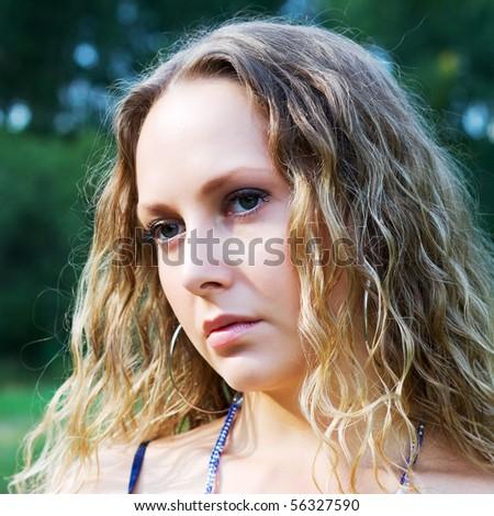 Sad woman looking away. - stock photo