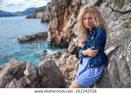Sad woman on a seaside - stock photo