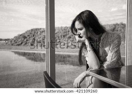 Sad woman or teenager girl in the glass house - stock photo