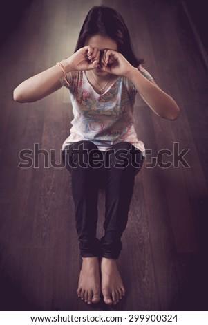 Sad woman sitting alone  - stock photo