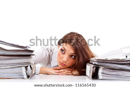 Sad woman with ringbinders sitting at the desk - stock photo