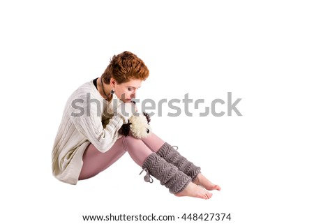 Sad woman with soft toy on the floor - stock photo
