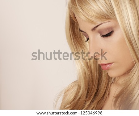 Sad young blond woman - stock photo