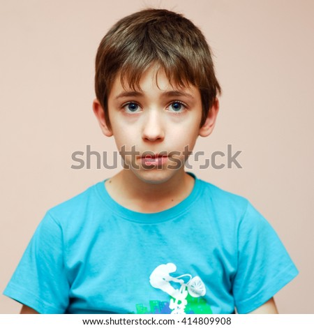 Sad young boy portrait
