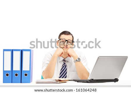 Sad young businessman in his office isolated on white background - stock photo
