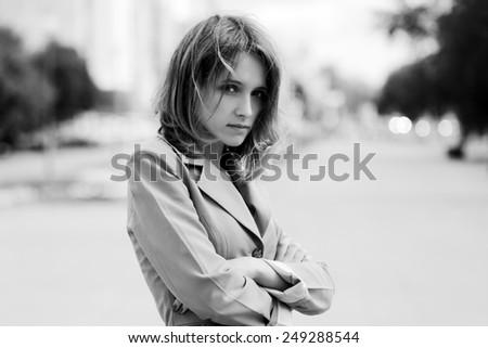 Sad young fashion woman on a city street - stock photo