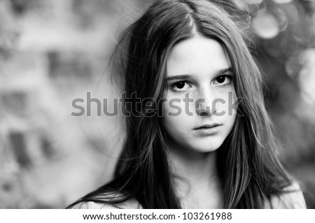 Sad young girl with long hair, a soft background - stock photo
