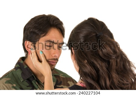 sad young hispanic military soldier saying goodbye to wife isolated on white - stock photo