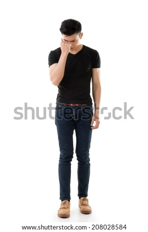 Sad young man, full length portrait isolated on white background. - stock photo