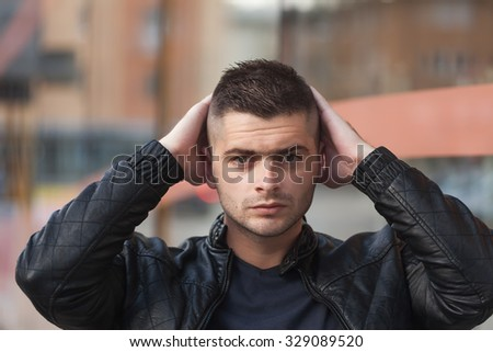 sad young man is holding the head - stock photo
