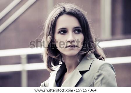 Sad young woman looking away - stock photo