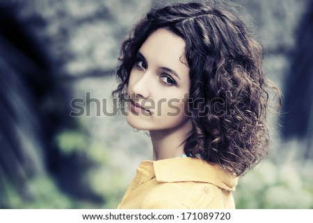 Sad young woman with curly hairs