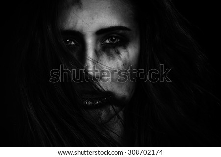 sad young woman with smeared cosmetcs makeup monochrome - stock photo