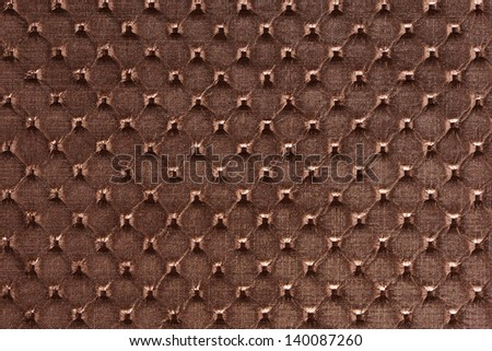 Saddle brown synthetic leather with embossed texture background - stock photo
