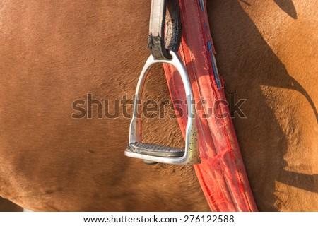 saddle stirrup - soft focus with film filter - stock photo