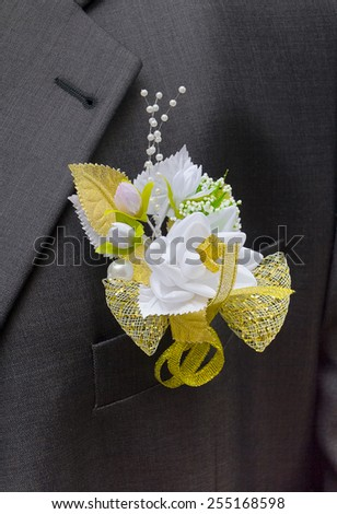 sadebnaya boutonniere for the groom's suit - stock photo