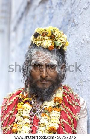 Sadhu at the ghats in Varanasi, India. - stock photo