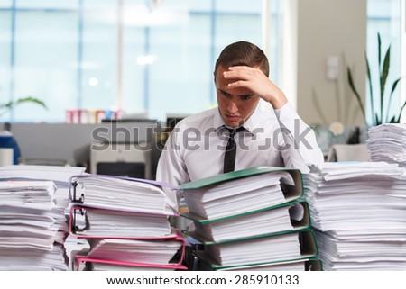Sadness manager have so many paperwork in the office