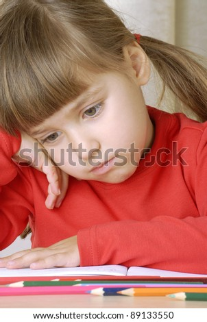 sadness schoolgirl portrait thinking and studding. - stock photo