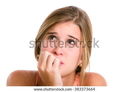 Sadness, sorrow, worries in a Hispanic young woman about to cry looking up and hands on face. - stock photo