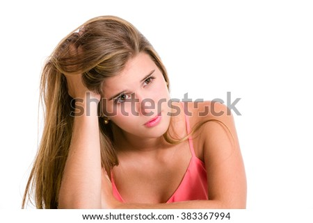 Sadness, sorrow, worries in a Hispanic young woman about to cry looking up and hands on head.  - stock photo