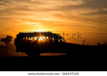 Safari car in sunset light Safari car in sunset light. Etosha National Park, Namibia, Africa.  - stock photo