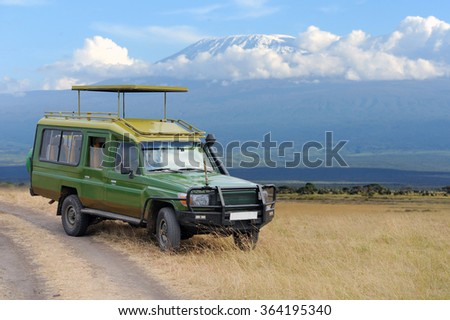 Safari game drive on Kilimanjaro moun background. Kenya, Africa - stock photo