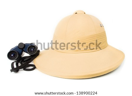Safari hat with a pair of vintage binoculars on white - stock photo