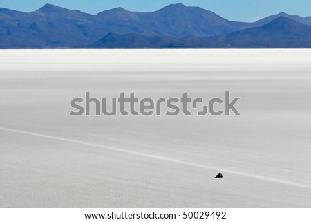 Safari on the world biggest salt flats in Bolivian Andes - stock photo