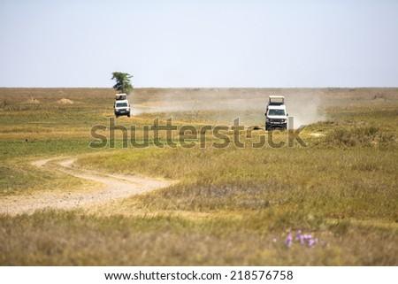 Safari tourists on game drive in Serengeti - stock photo