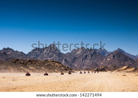 Safari Tours by quad bike in Egypt. Tourists riding quadbikes in desert.